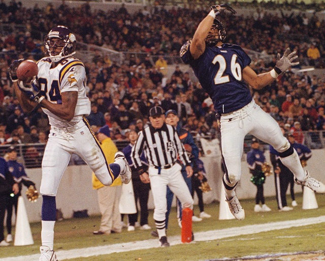 Randy Moss of the Minnesota Vikings soars into the end zone.