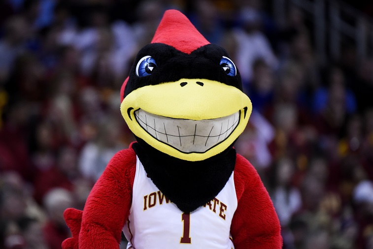 """Iowa State's """"Cy"""" the cardinal smiles for fans during a basketball game"""