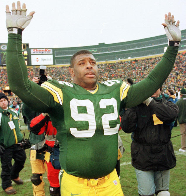 Reggie White greets fans after winning a game.
