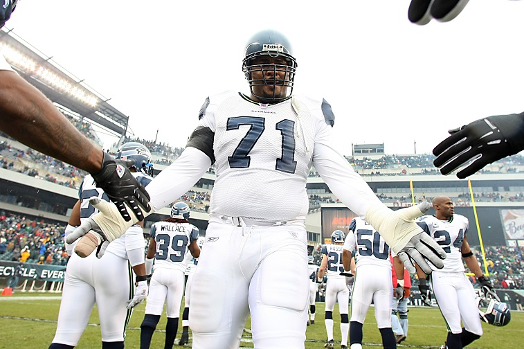 The Seattle Seahawks' Walter Jones is introduced on the field during an NFL game.