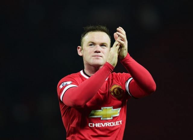 Wayne Rooney thanks the fans after winning a game.