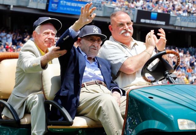 Yogi Berra waves to the Yankees faithful