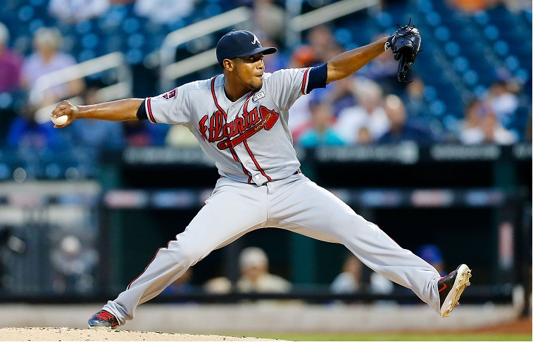 NEW YORK, NY - AUGUST 27:  Julio Teheran #49 of the Atlanta Braves pitches in the first inning against the New York Mets at Citi Field on August 27, 2014 in the Flushing neighborhood of the Queens borough of New York City.