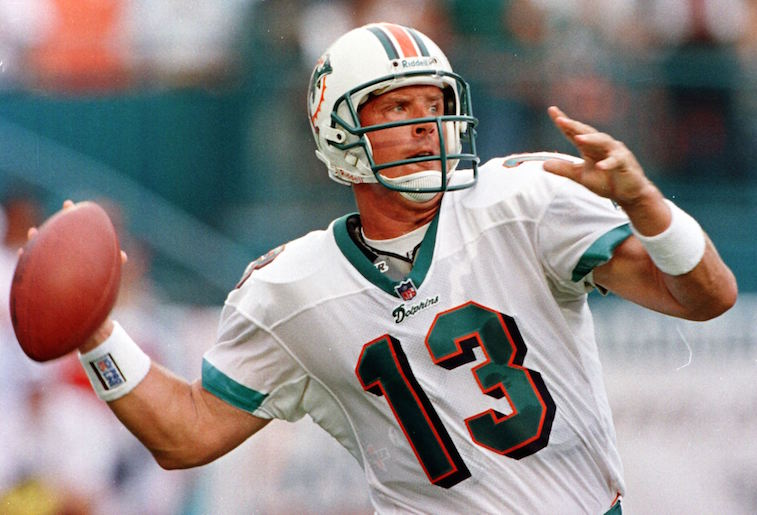 MIAMI, :  Miami Dolphins quarterback Dan Marino gets ready to throw a pass in first quarter action in Mimi's NFL season opener against the Indianapolis Colts 31 August at Pro Player Stadium in Miami, FL. Marino is starting his 15th year as Dolphins quarterback.