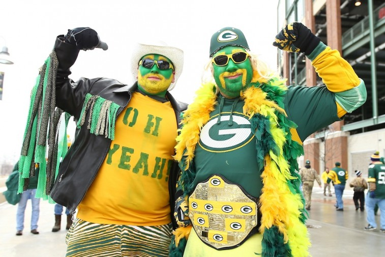 Green Bay fans pose for a picture.