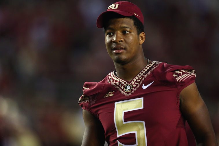 Jameis Winston watches game from the sidelines