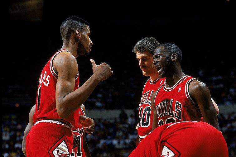 Michael Jordan huddles with teammates during a game