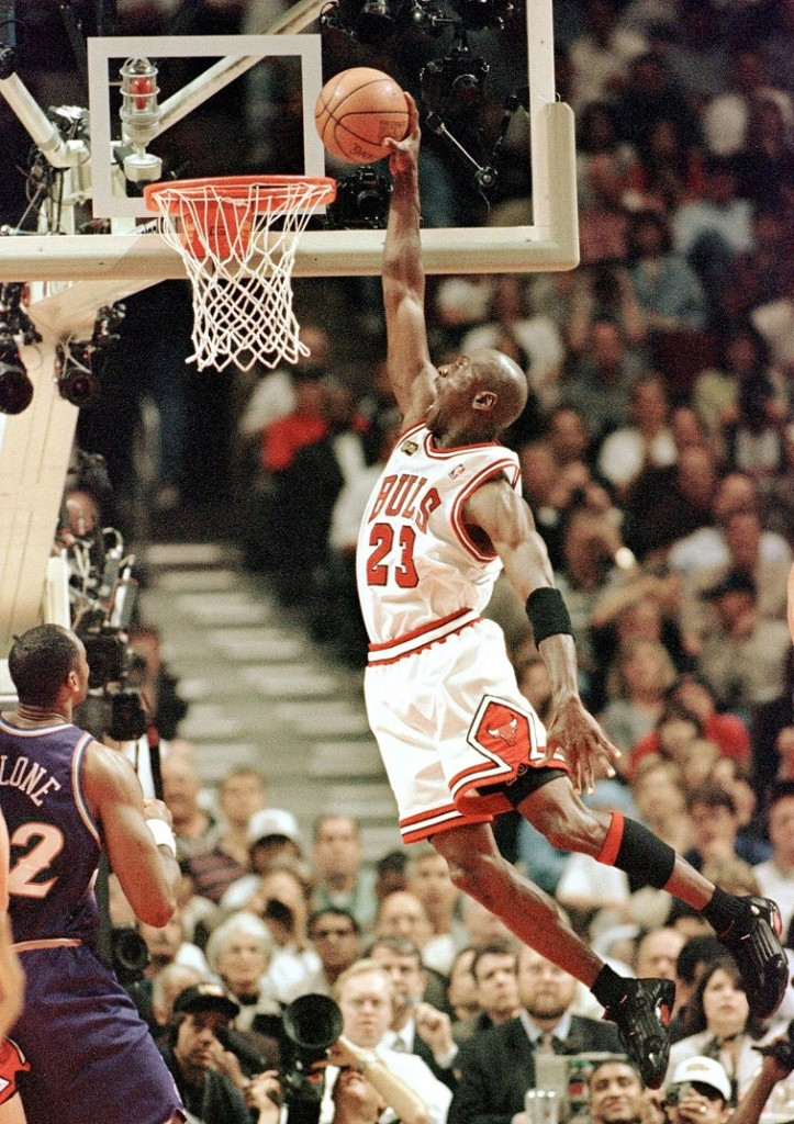 Michael Jordan goes for a huge dunk.