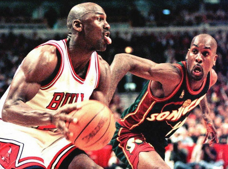 Michael Jordan sprints toward the basket.