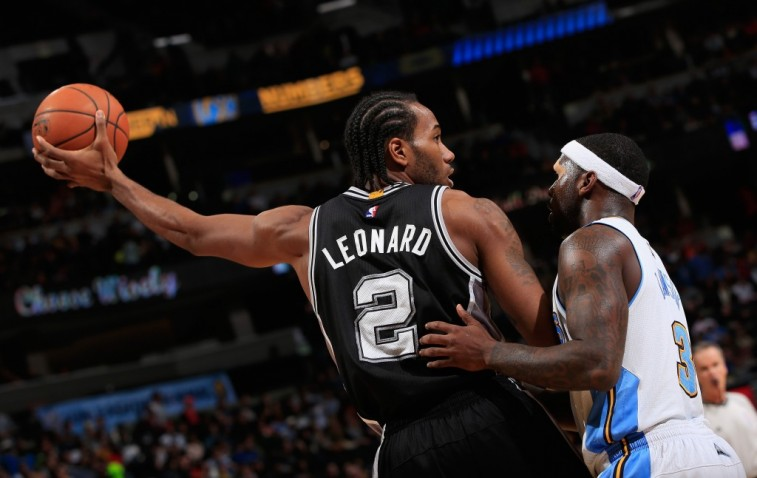DENVER, CO - DECEMBER 14: Kawhi Leonard #2 of the San Antonio Spurs controls the ball against Ty Lawson #3 of the Denver Nuggets at Pepsi Center on December 14, 2014 in Denver, Colorado. The Spurs defeated the Nuggets 99-91. NOTE TO USER: User expressly acknowledges and agrees that, by downloading and or using this photograph, User is consenting to the terms and conditions of the Getty Images License Agreement. (Photo by Doug Pensinger/Getty Images)