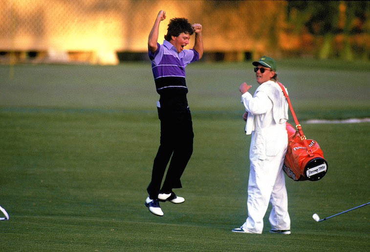 Larry Mize celebrates with his caddy.