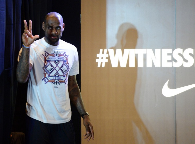 Four-time NBA Most Valuable Player, Lebron James of the Miami Heat, greets members of the media during a press conference in Manila on July 23, 2013. James is in the Philippine capital for a two-day visit as part of his 'Witness History' tour.