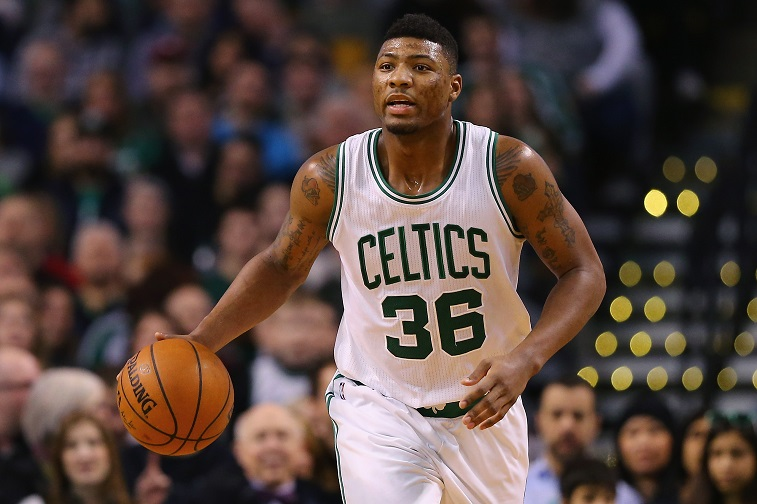 Marcus Smart dribbles the ball up the floor