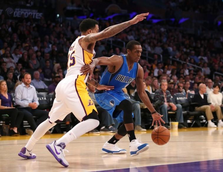 Rajon Rondo dribbles against the Los Angeles Lakers