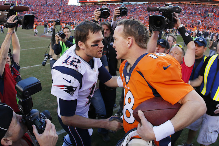 during the AFC Championship game at SpoPeyton Manning and Tom Brady shake hands at Sports Authority Field at Mile High on January 19, 2014 in Denver, Colorado.