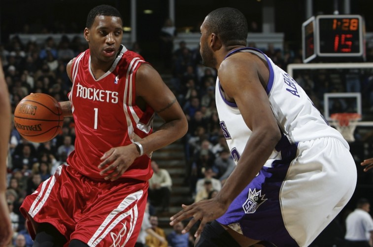 Tracy McGrady dribbles around a defender | Getty Images
