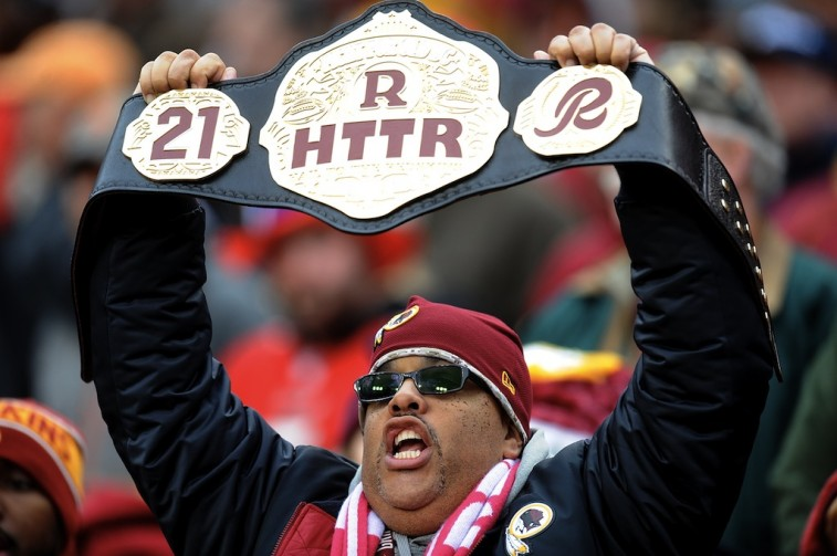 LANDOVER, MD - NOVEMBER 16: A Washington Redskins fan cheers during a game against the Tampa Bay Buccaneers at FedExField on November 16, 2014 in Landover, Maryland.