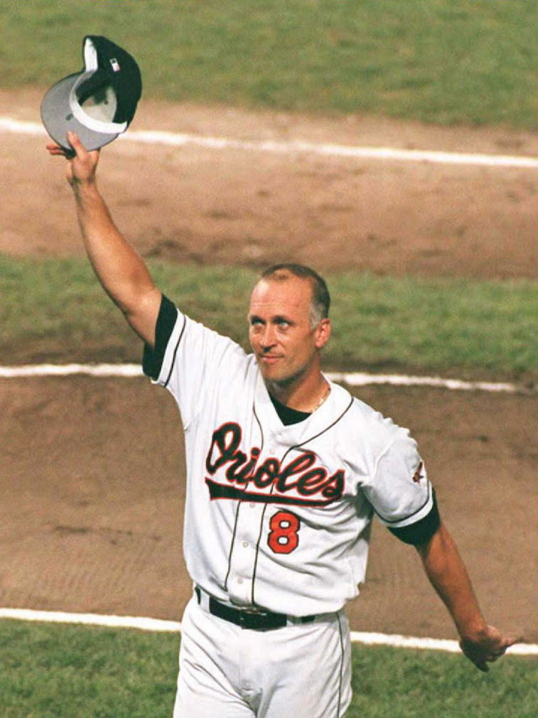 BALTIMORE, MD - DECEMBER 1: (YEARENDER 16) Cal Ripken, Jr., of the Baltimore Orioles, tips his hat to the fans in the middle of the fifth inning at Camden Yards in Baltimore 06 September after setting the record of 2,131 consecutive games played. Ripken broke the record set by Lou Gehrig. (Photo credit should read BRIAN BAHR/AFP/Getty Images)BRIAN BAHR/Getty Images