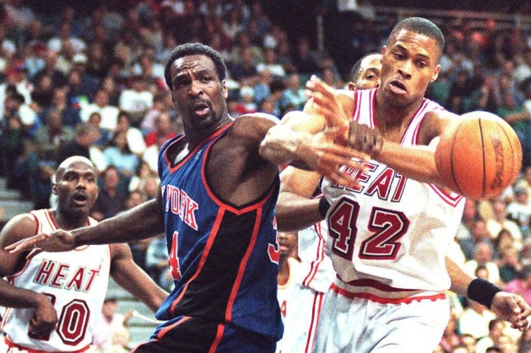Charles Oakley pushes an opponent away from the ball.