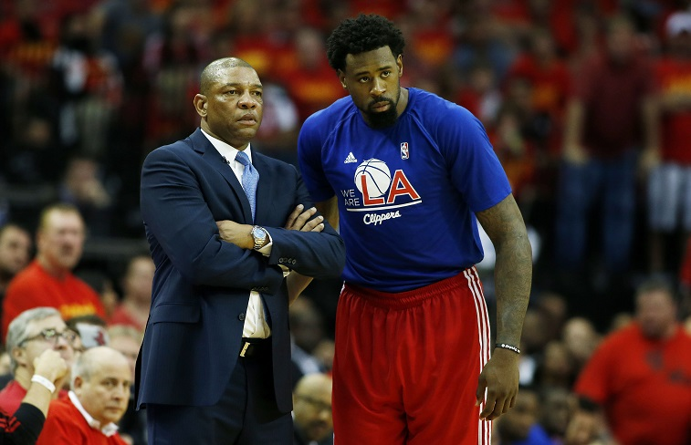 Doc Rivers and DeAndre Jordan chat during the postseason