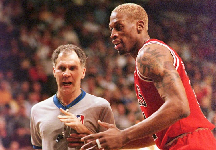 Dennis Rodman argues with a referee.