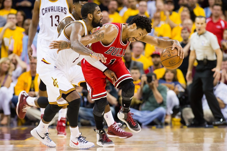 Kyrie Irving wraps up Derrick Rose.
