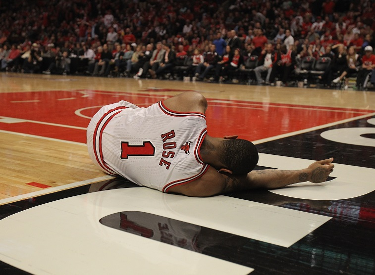 Derrick Rose laying on the court after being injured during a game