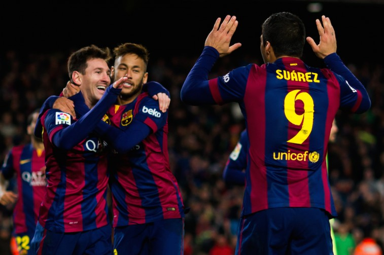 Barcelona players celebrate a goal