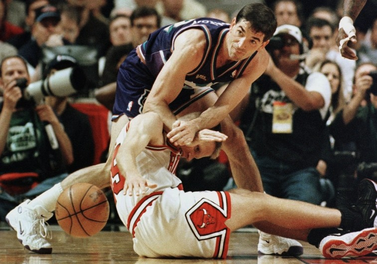John Stockton shoves a Chicago Bulls player.