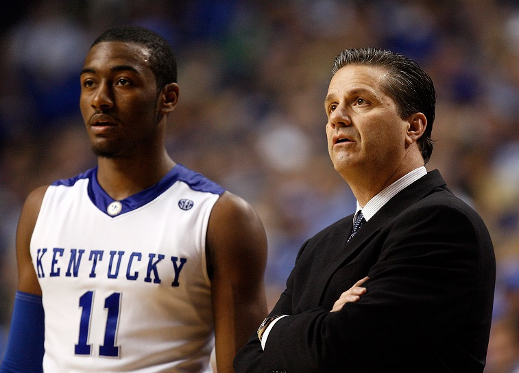 John Wall and John Calipari watch from the sideline.