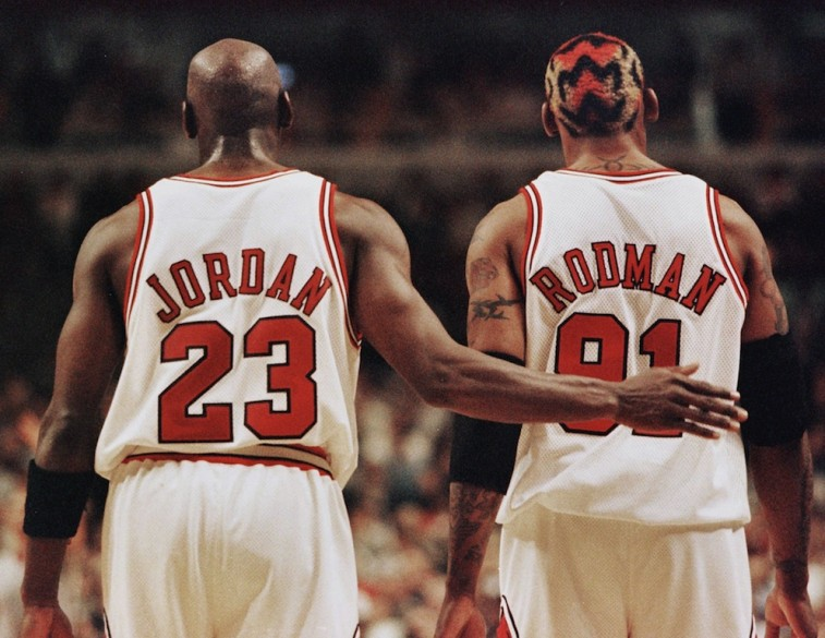 Michael Jordan and Dennis Rodman walk up the floor.