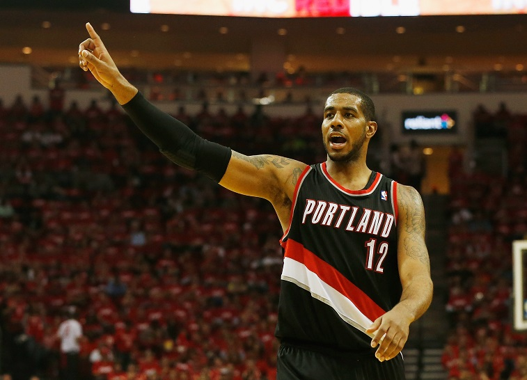 LaMarcus Aldridge signals to his teammates.
