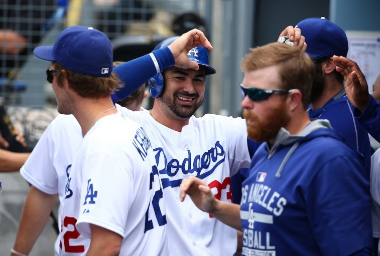Adrian Gonzalez is congratulated by teammates