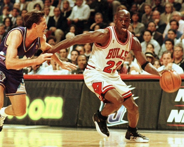 Michael Jordan drives to the basket.