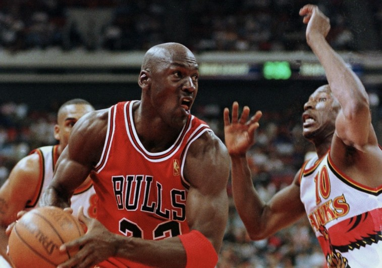 Michael Jordan tries to make a move around Mookie Blaylock