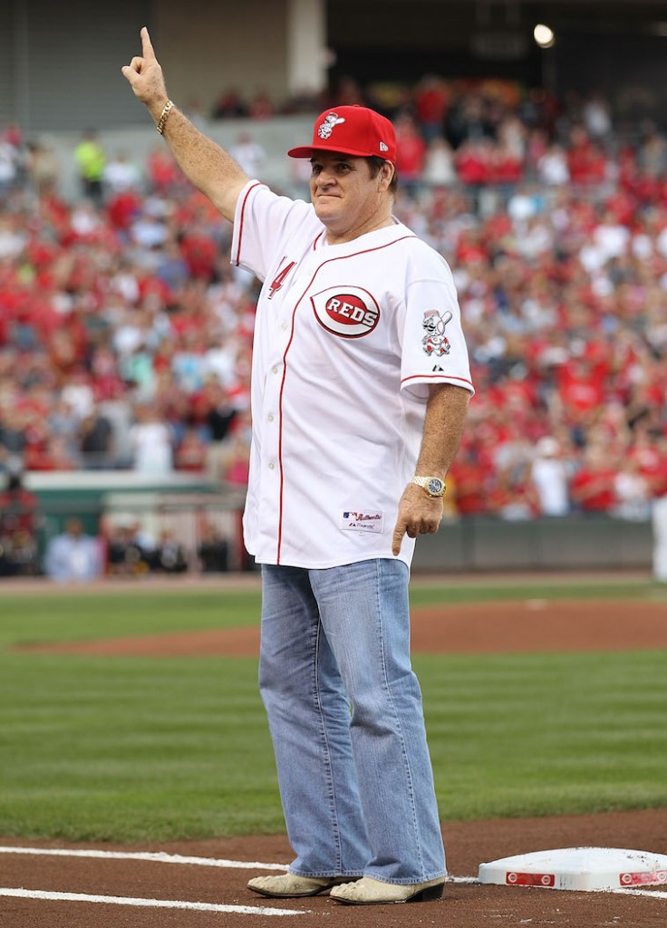 Pete Rose greets fans at a Cincinnati Reds game.