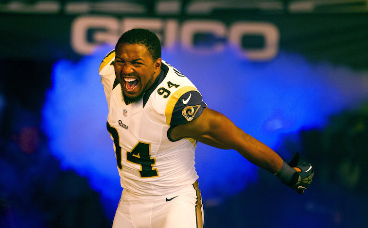 ST. LOUIS, MO - OCTOBER 21: Defensive end Robert Quinn #94 of the St. Louis Rams runs out during player introductions prior to the game against the Green Bay Packers at the Edward Jones Dome on October 21, 2012 in St. Louis, Missouri.  (Photo by David Welker/Getty Images)
