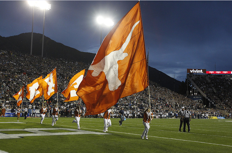 Texas Longhorns flags on the football field