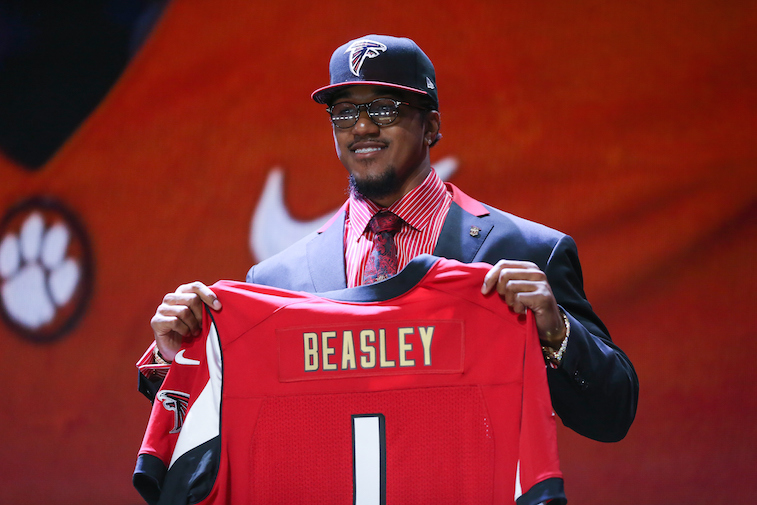 Victor Beasley of the Clemson Tigers holds up a jersey after he was picked No. 8 overall by the Atlanta Falcons during the 2015 NFL Draft.