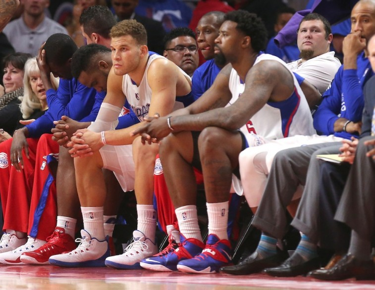 LOS ANGELES, CA - MAY 14: Blake Griffin #32 (L) and DeAndre Jordan #6 of the Los Angeles Clippers sit on the bench after Griffin fouled out in the final stages of the fourth quarter against the Houston Rockets during Game Six of the Western Conference semifinals of the 2015 NBA Playoffs at Staples Center on May 14, 2015 in Los Angeles, California. The Rockets won 119-107. NOTE TO USER: User expressly acknowledges and agrees that, by downloading and or using this photograph, User is consenting to the terms and conditions of the Getty Images License Agreement. (Photo by Stephen Dunn/Getty Images)