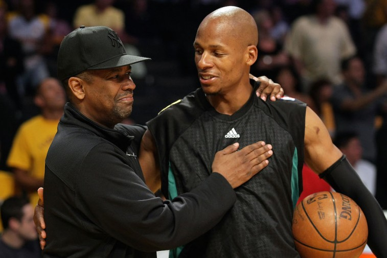 Denzel Washington congratulates Ray Allen on a win.