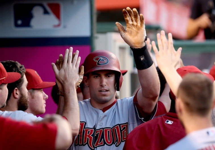 Paul Goldschmidt celebrates with teammates in dugout after home run