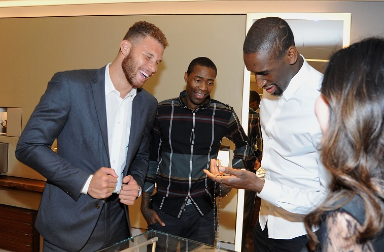 Blake Griffin checks out the goods at a promotional event.