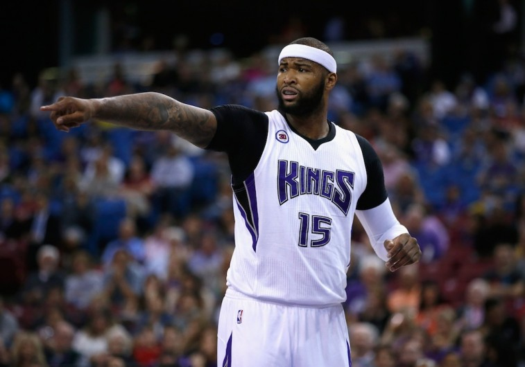 DeMarcus Cousins points at his teammate during a heated game