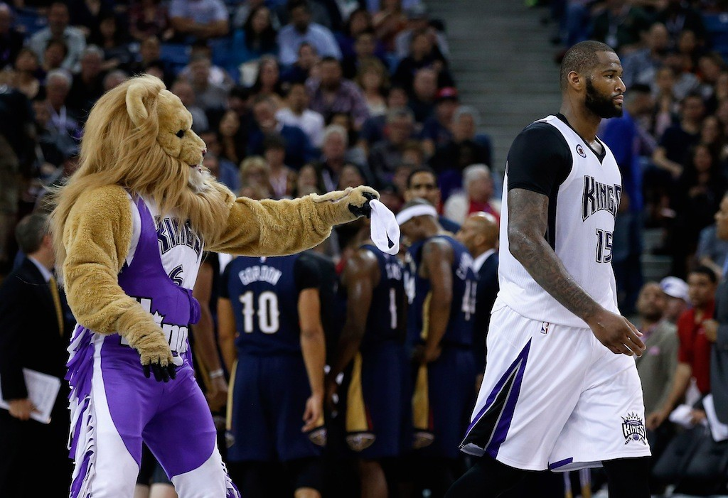 DeMarcus Cousins interacts with the Kings mascot, Slamson the Lion