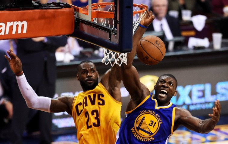 Festus Ezeli and LeBron James battle for ball in Game 3