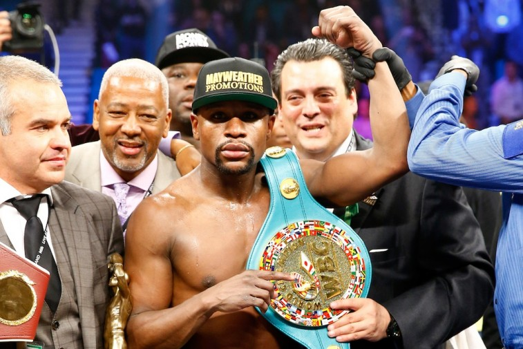 Floyd Mayweather Jr. celebrates his victory over Manny Pacquiao