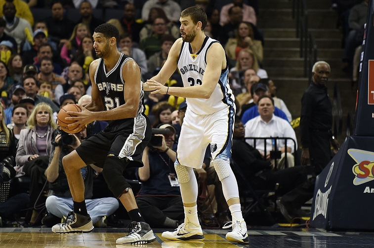 Gasol guards Duncan at the FedExForum on December 30, 2014 in Memphis, Tennessee.