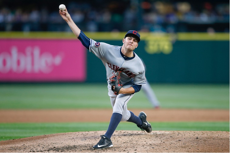 Trevor Bauer pitches despite a drone-related injury on his pinky finger.