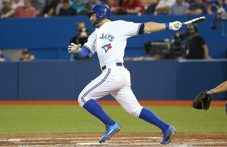 TORONTO, CANADA - JUNE 18: Kevin Pillar #11 of the Toronto Blue Jays hits an RBI single in the second inning during MLB game action against the New York Mets on June 18, 2015 at Rogers Centre in Toronto, Ontario, Canada. (Photo by )